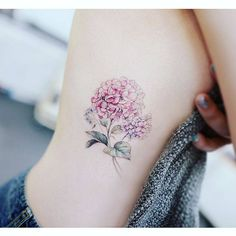 Hydrangea tattoo on the right side ribcage.