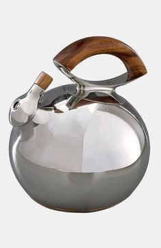 Nambé 'Bulbo' Kettle. A fanciful swell of stainless steel shapes a beautiful kettle accented with the warm tones of acacia wood.