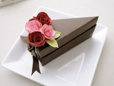 """Looking for some unique wedding favors or boxes? These cake slice boxes are perfect for both weddings and bridal showers – by Imeon Design. Each of the cake slice boxes is custom-made, features """"icing"""" paper flowers. You can also use these cake slice boxes as charming centerpieces – just  place boxes together to create a 'whole cake' on top of a cake stand in the center of a table. Or, use individually as favor boxes at each guest's place setting. Your guests would love them! Wedding Cake Boxes, Cool Wedding Cakes, Wedding Favors, Wedding Blog, Wedding Ceremony, Dream Wedding, Cake Slice Boxes, Box Cake, Birthday Party Decorations Diy"""
