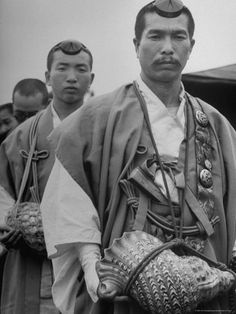 White Japanese Buddhist Priests from the Mountains with Large Conch Like Shells Around Their Necks – Photographic Print by Margaret Bourke-White Documentary Photographers, Female Photographers, Margaret Bourke White, Fortune Magazine, Life Magazine, Photojournalism, Priest, Traditional Dresses, The Magicians