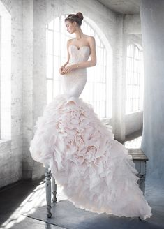 LAZARO Style 3612 Blush textured fit to flare bridal gown, strapless sweetheart neckline, beaded Chantilly lace elongated bodice with thin satin ribbon at natural waist, ruffled organza skirt, chapel train. Also available in Ivory.