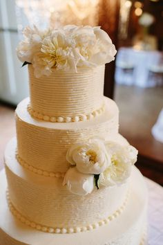 white cake with peonies - so pretty!!