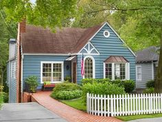 White Picket Fence: Charming Front Yards, HGTV Magazine >> http://www.hgtv.com/decorating-basics/curb-appeal-steal-the-look/pictures/page-14.html?soc=pinterest