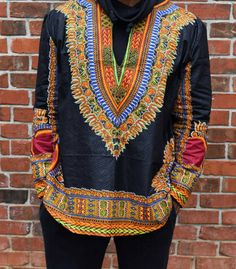 Check out this item in my Etsy shop https://www.etsy.com/uk/listing/257518059/africanethnic-black-long-sleeves-dashiki