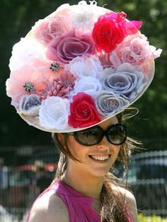 winnaethaa:    Royal Ascot's crazy hats  Hat designer Tessa Cunliffe wears one of her own Bowe Blood creations.