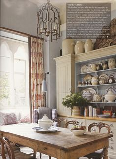 English Country- off whites, blues, wood, like the dresser with cupboards either side.