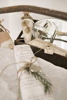 wrapping: calligraphy on packing paper in gray or black ink; sage and silver accents