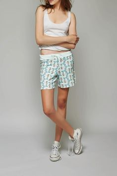 Featuring a repeat print of a stylin' mermaid on a light mint colored brushed fleece with vintage distressed finish. Low rise, drawstring lounge shorts with raw edge hem. Softest feel and lightweight for yoga or summertime lounging.   Blue Mermaid Shorts by All Things Fabulous. Clothing - Shorts - Printed Los Angeles, California