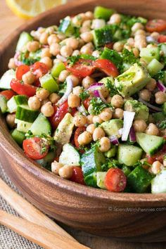 Chickpea Salad combines all of my favorite fresh vegetables in one delicious bite. Chickpeas are combined with juicy tomatoes, refreshing cucumbers and creamy avocados all tossed in an easy homemade lemon kissed dressing. #spendwithpennies #chickpea #chickpeasalad #saladrecipe #makeaheadsalad #lunchrecipe #easyrecipe #easysidedish #potluck #bbq Chickpea Salad Recipes, Cucumber Recipes, Easy Salad Recipes, Simple Recipes, Recipes Dinner, Vegetarian Christmas Recipes, Vegetarian Recipes, Healthy Recipes, Burger Side Dishes