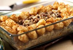 Beefy Hash Brown Potato Casserole-  Hungry guests clamor for more when you serve this well-loved, old-fashioned, potato-topped casserole.