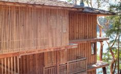"""""""Vertical strips of cedar siding disguise the exterior staircase to guest areas"""""""