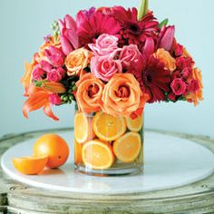 Orange Blossom Bouquet Administrative Professionals' Week is coming up! Celebrate your special assistant with this beautiful arrangement loaded with blooms and a citrus splash!  April 22-28, 2012