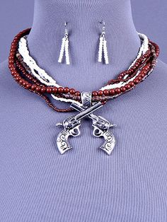 Cowgirl Bling Ranch, LLC - Double Pistol Beaded Necklace and Earring Set Brown, $15.99 (http://www.cowgirlblingranch.com/products/double-pistol-beaded-necklace-and-earring-set-brown.html)