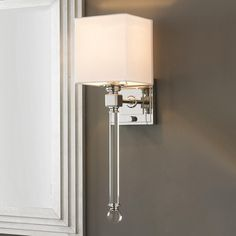 "Chic Sophisticate Crystal Torch Wall Sconce Crisp white cube shade, towering crystal rod with clear ball finial, and shiny nickel square fittings give this wall sconce its suave style. (20""Hx6""Wx7""D"