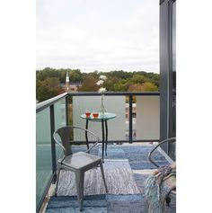 Layered denim re:loom rugs transform this balcony into a peaceful retreat. Photography by Christina Wedge and styling by Alex Mia Hernandez... love this photo :) And these rugs!