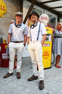 (L-R) Fernando Alonso of Spain and Ferrari and Felipe Massa of Brazil and Ferrari appear at a 1950's inspired Shell event at Le Globe cinema in Malmedy during previews to the Belgian Grand Prix on August 22, 2013 in Malmedy, Belgium.