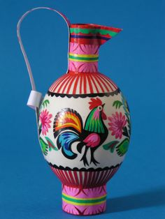 A vase decorated in the traditional folk pattern of the Polish region of Łowicz