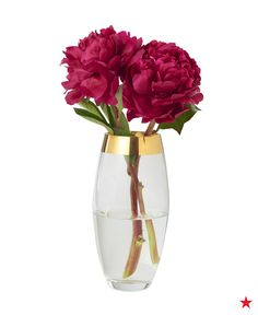 A gold dipped vase from Mikasa and your favorite flowers make for a bright & cheerful centerpiece.