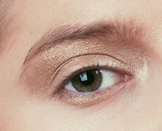 Fresh and simple gold eye makeup.