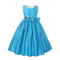 Your little girl will look amazing in this special occasion flower girl dress by Kiki Kids. This stylish satin turquoise dress features a boat neck, a flared skirt, a bow and a silver sequin accented waistline. It is sleeveless and has a ribbon bow at the