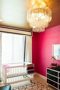 Can we talk about that bright pink grasscloth wall? It creates such a statement but is also the perfect backdrop for the rest of the black, gold, and white pieces.  Source: Diana Relth