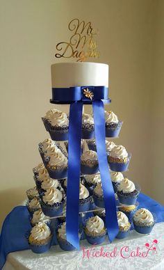 Gold and navy blue themed wedding cake cupcakes  www.wickedcake.com