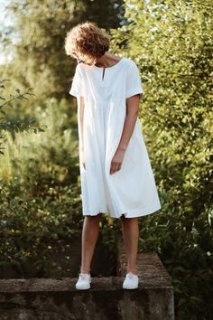 This simple cotton dress may just be the only thing you ever need to wear this summer: with short folded sleeves, notch detail in the neckline, hand gathered skirt, and hidden pockets it's the perfect everyday look.