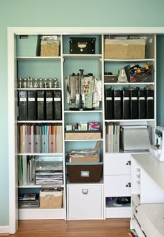 I had the doors taken off of this closet in order to open up the room. This also makes getting to things easier . The white shelving is a closet organizer