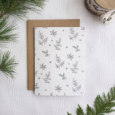 Minimalist holiday card with foliage, botanical Christmas card, illustration by Joannie swell