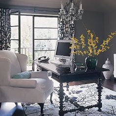 Modern and cozy office! By placing your desk  away from a wall it gives a sense of importance and will make you feel like an executive! :) Who doesn't want that?