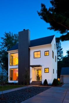 Modern farmhouse - love the charcoal/slate colored modern chimney seen from the outside