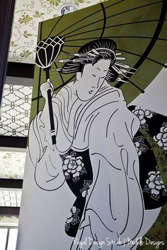 This classic Japanese Geisha graces an 8' high door in one of our offices. (Modello EasPan137) You can catch a peek of more Modello™ vinyl stencils on the ceiling beyond!