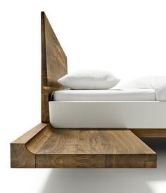 Floating like magic, the Riletto nightstands are sleek and minimalist #walnut #solid #wood #bed #interior #design
