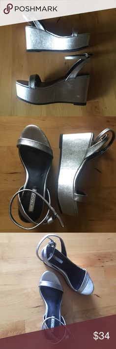 Aldo silver wedge strappy sandals size 6 Also wedge sandals size 6. Good condition, silver, straps wrap around ankle-really cute! Aldo Shoes Wedges