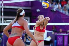 Misty May-Treanor and Kerri Walsh continue their unbeaten streak into the finals of beach volleyball. I love watching them: they are consistent, strong teammates, and Misty's curves betray her straight demeanor.