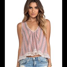 """Free People Flutter Fly tank top V-neck - Sleeveless - V-back with self-tie strap detail - Allover print - Raw edge mesh trim throughout - Embroidered mesh trim hem with scalloped edge - Sharkbite hem - Lined - Approx. 19"""" shortest length, 23"""" longest length - Imported Fiber Content: Body: 100% polyester Lining: 100% polyester Trim: 65% cotton, 35% nylon Care:Machine wash Fit: this style fits true to size. Brand new with tag. Retail price $78. Smoke free and pet free home. Free People Tops…"""