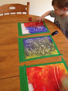 Paint in a gallon size zip lock bag, taped to the table!  Great idea for entertaining kids, while sparking their imagination (and keeping things clean)