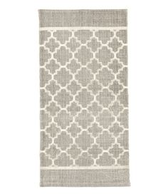 Gray. Rectangular rug in woven cotton fabric with a printed pattern at front.