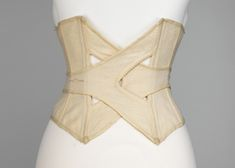 A view of the back of this very awesomely constructed circa 1902 wool bathing corset.    When you consider the cut of stylish turn of the century bathing suits it's easy to see why bathing corsets were necessary.