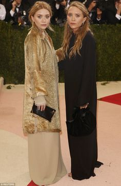 Black and gold: Mary-Kate and Ashley Olsen went for a dramatically different look from the crowd at the Met gala on Monday