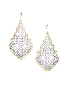 With a mix of our rhodium silver surrounded by yellow gold, these Kendra Scott earrings are a must have. French hook. 14K Gold and Rhodium Plated Brass.