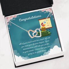 This necklace is a great way to show a special graduate how proud you are of their accomplishment of completing their finance degree.The message card says: all of your hard work has payed off and you have your finance degree. Your determination will help you go far in your career. I know that you are going to do great things. #finanacegraduate #financedegreegift #giftforfinancegraduate Finance Degree, Double Heart Necklace, Graduation Necklace, Message Card, Working Moms, Hard Work, Determination, Btc Trading, Congratulations