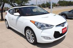 2012 Hyundai Veloster with Red Interior.  Equipped with Style Package which includes:  Panoramic Sunroof, Alloy Foot Pedals, Dimension Premium Audio System with subwoofer, Front Fog Lights and more!