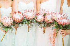 King Protea and Eucalyptus Bouquets. See other bridesmaid holding the King Protea and Eucalyptus Bouquets