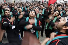 Ashura Observances 2013: Turkish Shiite men beat their chests as they mourn during an Ashura procession, Istanbul - Found via Buzzfeed