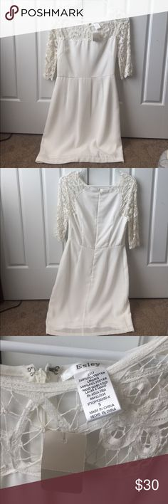 NWT white lace detail dress perfect for bride NWT 3/4 sleeve white dress with lace detail at the top. Bought from a boutique and never ended up wearing it. Perfect for brides for engagement parties, rehearsal dinners, etc. Flattering empire waist and zip closure in the back. Dresses