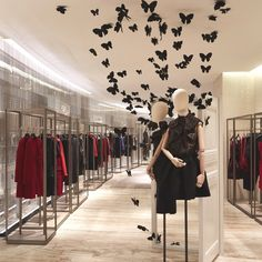 Super modern clothing store. Love the cube racks! #interiordesign #retaildesign #modern