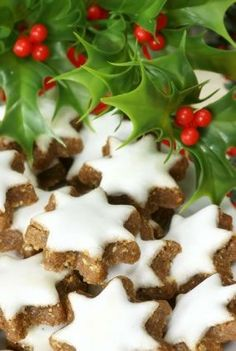 German and Swiss Cookie Zimtsterne: 2 cups finely ground unblanched almonds, plus 1/2 cup more as needed  1 1/2 tablespoons cinnamon  4 large egg whites  4 cups powdered sugar, sifted  1 tablespoon fresh lemon juice  1 teaspoon lemon zest  granulated sugar (for rolling out)