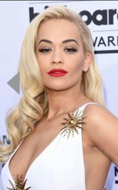 Rita Ora with  40 &50's  gown and hair styles