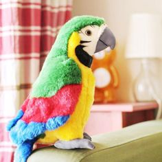 Our adorable talking parrot plush toy mimics every word and sound you make in a fun-loving high-pitched tone. Your new little friend is guaranteed to bring laughter and fun! Age Range: Years Old Gender: UnisexHeight: 26 cm Dimension: 12 x 11 x Plush Dolls, Doll Toys, Talking Parrots, Talking Toys, Colorful Parrots, Cheap Toys, Good Communication Skills, Parrot Toys, Electronic Toys